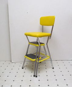 Vintage Cosco Kitchen Stool -  Step Ladder -  Yellow and Chrome. $150.00, via Etsy.