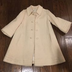 """Vintage White Ivory Boucle Wool Swing Jacket Incredible! I bought this at an estate sale and have worn it once! It is in incredible condition! The original owner cared for this coat very well! No snags, tears, or stains. Has all the buttons! I am 5'5"""" and weigh 150, the jacket fit well with some room to give. I'd imagine it's about an 8 or 10 in today's sizes. I imagine the style has it loose so it can be worn over dresses. Vintage Jackets & Coats"""