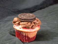 The Creative Cupcake...Moist Red Velvet layer on the bottom followed by strawberry cream cake filled with strawberry marshmallow creme and topped with thick chocolate buttercream and an Oreo-the flavor is divine!