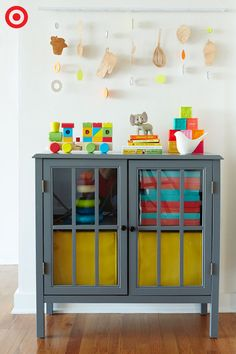 A handsome storage piece, like the Windham accent cabinet by Threshold, is a real find for Baby's nursery. The cottage-style doors have a country look you love, and it's the perfect place to store bedding, baby essentials, toys and more. Decorate the top with colorful accents and hang a fun mobile above, and you'll have room organization at its best and brightest.