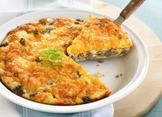 Impossibly Easy Cheeseburger Pie - Hamburger, onion, cheese, bisquick, milk, eggs - wah la!