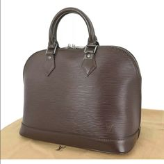 Louis Vuitton Epi Chocolate Alma LOUIS VUITTON Alma Made In:France Code:AR 1010  Color:Brown Material:Epi leather and alcantara lining Features:Spacious interior.  One inside open pocket. Size in inches (approx.):W 11.9 x H 9 x D 6.25 Size in cm (approx.):W 30 x H 23 x D 16 Handle drop in inches:3 Handle drop in cm:8 Comes with:Dustbag.  . Louis Vuitton Bags Satchels