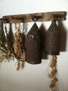 punched tin lanterns and drying bunches on a rustic pegboard...