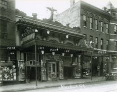 1418-1428 Market Street. Businesses shown line the south side of the street, near the southwest corner of Fourteenth Street and Market Street. (1923) ©Missouri History Museum