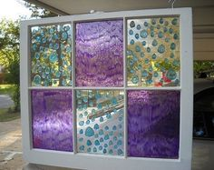 This is a guide about faux stained glass recycled windows. You can easily create beautiful stained glass looking windows using recycled windows and adding paint or other embellishments.