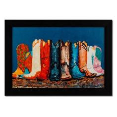 Wild, Wild West. Kick up your heels all year long with the festive Boots print! Multiple cowboy boots, rendered in a painterly fashion, display a myriad of brilliant hues and unique designs. The horizontal giclée fine art print on canvas is trimmed by a solid black frame to contrast the bright and colorful artwork -  sure to liven up any space.