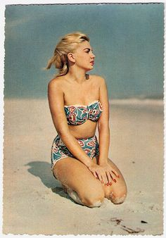 Wind blown hair, sand on your knees, and a cute two-piece, that's what summer is all about. #vintage #summer #beach #1950s #bikini
