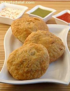 "Khasta actually means ""flaky"" and this flaky kachori is filled with a delectable moong dal mixture and deep fried. Remember to fry the kachori on a very slow flame so that the crust is crisp and gets cooked on the inside.   A perfect kachori is one that is puffed up and flaky outside but hollow inside.   This dish can be stored in air-tight containers for upto a week. When unexpected guests arrive, warm up the kachoris in a slow oven for about 7 to 10 minutes, fill them with curds and…"