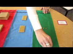 """A demonstration of how the golden beads materials are used to teach dynamic addition in the Montessori method, presented by Bluffview Montessori School, Winona, Minnesota. In the demonstration, the golden beads are used to demonstrate the addition of two four-digit numbers (e.g., 1563 + 8265). This is a Montessori """"work"""" that is typically used a..."""