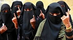 moslim women give a voting finger