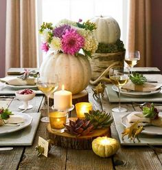 White pumpkins and small succulents set a serene Thanksgiving scene. More Thanksgiving centerpieces: http://www.midwestliving.com/homes/seasonal-decorating/holiday-ideas/easy-thanksgiving-centerpieces/