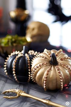 Add a little edge to your Halloween decor with these black and gold spiky pumpkins. Group a few of them together to create a centerpiece that really makes a statement, or line some up on a mantel and intertwine them with string lights to add spook to a living room or family room.