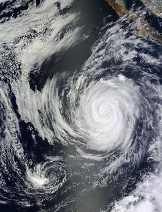 In early July two simultaneous hurricanes blew over the eastern Pacific Ocean: Hurricane Emilia and Hurricane Daniel. Tornados, Natural Phenomena, Natural Disasters, Mother Earth, Mother Nature, Weather Storm, Wild Weather, Image Of The Day, Earth From Space