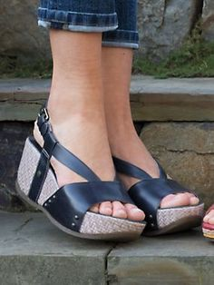 Step up to wedge-heeled fun in Women's Bussola Sun Chaser Sandals. Leather  shoes with basket-weave wedges have thong-style toe posts for comfort.