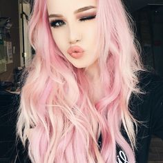 Pink hair, don't care!! YAASS Girl. Hailie is perfect in pink with mermaid luscious hair. Add a wink and a sweet kiss to up your selfie game!