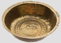 A cast brass basin (Beckenschlägerschüssel) with hunting decoration Nuremberg, around 1500