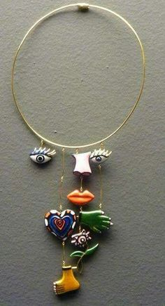 picasso-type, eyes, nose, mouth, hand, foot, mobile necklace