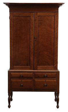 Southern Federal Cherry Press Cupboard possibly Kentucky, early 19th century, two-case construction, upper case with two paneled doors opening to a fixed shelved interior, bold cornice molding, lower case set with four dovetailed drawers with faceted facings, turned legs and feet, 78 x 38-1/2 x 19-1/2 in