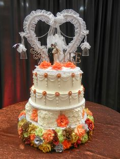 swags and orange roses wedding cake wwwcheesecakeetcbiz wedding cakes charlotte nc