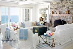 White slipcovers in the living room, add a cool and relaxed feel for those summery days and nights.