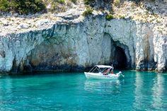 Caves in Marathonisi Island. The Turtle Island.