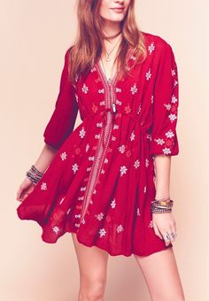 A drawstring Empire waist cinches the silhouette of this gauzy tunic dress from Free People. It's styled with a plunging neckline and gathered three-quarter-length sleeves for a fun, vintage look.