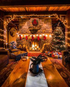 in a Cabin with a warm, cozy fireplace.Christmas in a Cabin with a warm, cozy fireplace. Why do we work so hard to make getting home simple? 🤔 Because it's where we eat together, of course! Cozy Christmas, Rustic Christmas, Christmas Fireplace, Christmas Stockings, Cabin Christmas Decor, Christmas Decorations For The Home Living Rooms, Christmas Trees, Christmas Lights, Vintage Christmas