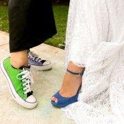 Bride wears blue suede heels by L.K. Bennett; guest wears mismatched Converse sneakers.