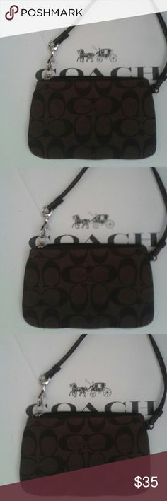 NWOT Beautiful COACH signature wristlet NWOT Beautiful designer brand new COACH signature wristlet. No flaws or wear ,super cute!perfect condition, detailed, detachable strap to attach to any purse. Colors are Brown and dark chocolate brown with COACH signature logo design ALL around entire wristlet.NWOT, just took tags off , roomy interior for all your essentials. Selling this beautiful designer brand for a great price!New! COACH  Bags Clutches & Wristlets