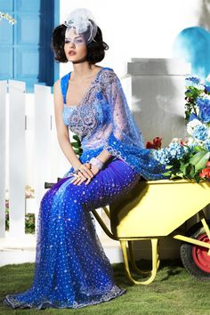 Unique shaded blue net saree with attractive look