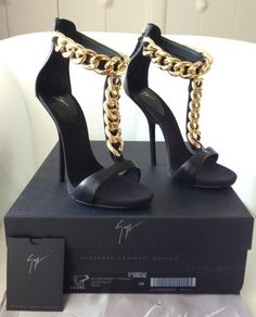 Giuseppe Zanotti sandals glack and gold via Luxury store. Click on the image to see more!