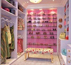 pinkish accent wall with glass shelves for shoe display, by Designer Jamie Drake