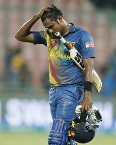 A dejected Angelo Mathews walks off the field , England v Sri Lanka, World T20 2016, Group 1, Delhi, March 26, 2016