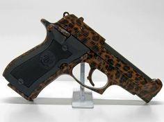 leopard pistol - now only if it had a pink handle
