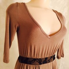 Stretchy brown dress w/black lace accents. Stretchy brown dress w/black lace accents. 95% Rayon 5% Spandex. 3/4 sleeves. Delicious Dresses