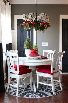 Chandelier With Spotted Shades, Fresh Greens and Festive Ribbon - 2015 Holiday House Tour