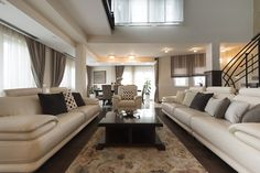 Luxury living room with large cream leather couches