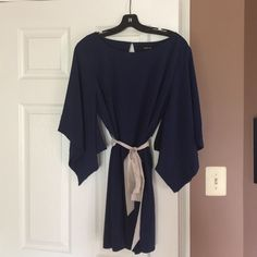 Navy blue dress/tunic with beige tie Such a beautiful dress!!! I wore it once for my birthday party and its been hanging in my closet since.  She deserves to be taken out on the town:-) Ark & Co Dresses Mini