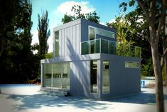 L41 Storey | Architect: Michael Katz  | Artist: Janet Corne |  This prefab home is ultra-compact, built with green materials and energy efficient. Designed to be constructed on piers or a four-point foundation, the home could easily be located on any site with minimal impact.