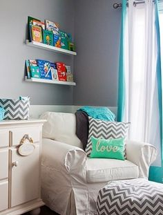 We love the bright, modern details in this nursery, especially the chevron ottoman and pillows with the grey-and-turquoise color scheme. www.thebump.com