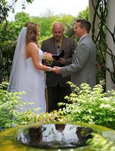 The couple exchanged vows in the hotel's Don Rives Cloister Garden, on a lovely spring afternoon.