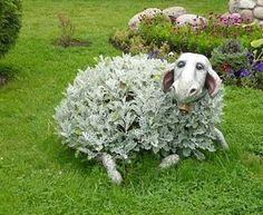 Love this!  A natural bush (looks like dusty miller) and add a ceramic sheep head? and feet  to look like a critter in the yard.  too cool! Unique Gardens, Amazing Gardens, Beautiful Gardens, Garden Crafts, Garden Projects, Yard Art Crafts, Outdoor Art, Outdoor Gardens, Jardin Decor