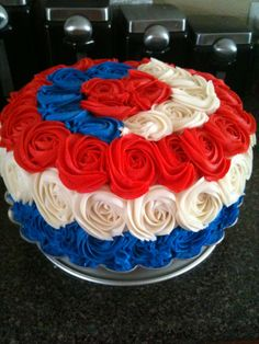 - This was a 5 layer vanilla cake with buttercream filling.  The inside is constructed to look like the American flag.  The outside is decorated with buttercream rosettes.
