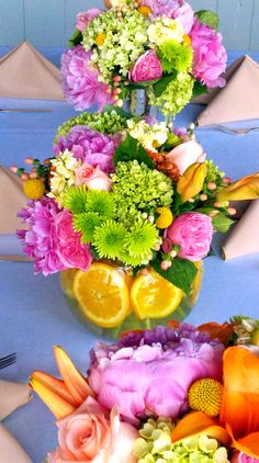Pink, green, and yellow centerpieces with orange slices. Wedding at Lenora's Legacy in Campobello, SC. http://www.lenoraslegacy.com/