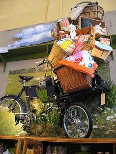Dutch bicycle hilariously stacked with baskets.  A true utility bike.