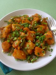 Idli Manchurian is an Indo Chinese food recipe that is easy and quick to prepare. Idli pieces are dipped in maida batter and deep fried before sauteing in spring onions and soy sauce, tomato sauce and garnished with spring onion greens.