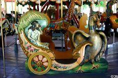 Duck pulling cart on Herschell-Spillman Carousel at Greenfield Village. Dearborn, MI.