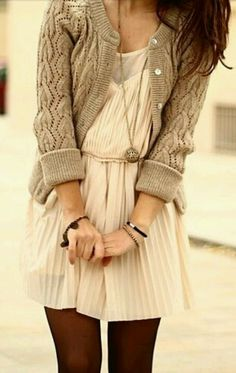Nice trick to turn a spring dress for fall. I love the pretty dress with a great, comfy cardigan or sweater. Pair it with tights and cute boots for the cooler weather. Fun, casual and pretty