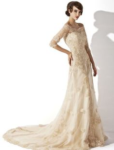 Modest ivory lace wedding dress with 3/4 sleeves off the shoulder