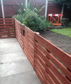 My first attempt at using pallets and I must say did find it quite easy to make this Easy Pallet Fence Patio Surround. I used for the posts. I painted garden, outdoor, recycling wood pallets DIY Pallet Projects, Other Pallet Projects, Pallet Fences Wood Pallet Fence, Pallet Decking, Diy Fence, Backyard Fences, Fence Ideas, Backyard Ideas, Patio Fence, Garden Pallet, Fence Gate